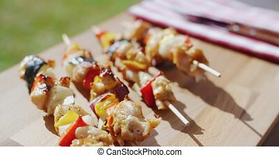 Crispy cooked chicken vegetable kabobs - Row of four crispy...