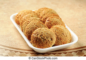 Crispy cookies in styrofoam tray
