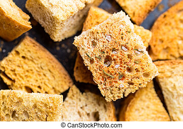 Crispy croutons with spices. Macro shot of roasted crouton