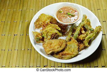 crispy fried vegetable coating flour and egg eat couple with spicy shrimp pasted sauce on plate