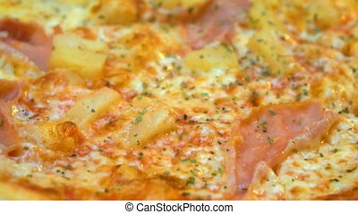 Crispy hot pizza with ham and pineapples.