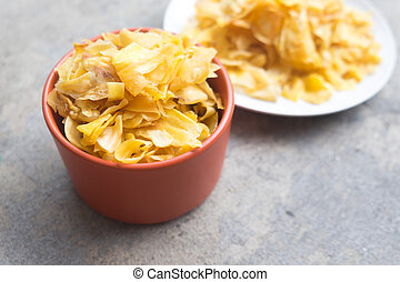 Crispy Jackfruit chip in orange bowl