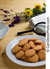 Crispy lemon biscuits on white plate