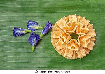 Crispy lotus blossom cookies isolated on white. Thai ...