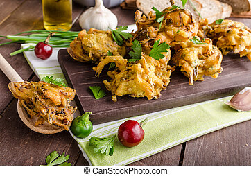 Crispy onion bhajis, delicious street food, with herbs and...