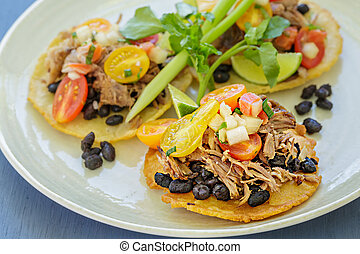 Crispy Pork Tacos - Mini tostadas with crispy pork, black...