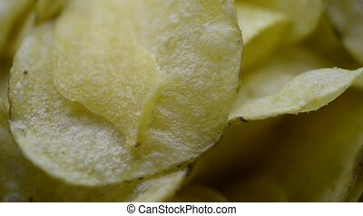 potato chips rotating - crispy potato chips rotating, macro...