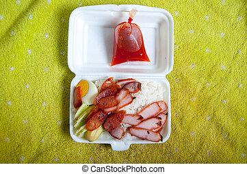 Crispy roasted belly pork chinese style and rice in foam box