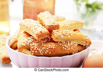 Crispy snacks topped with sesame seeds - detail