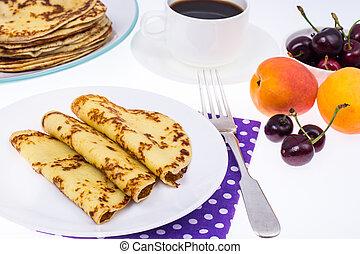 Crispy thin pancakes on plate, light background