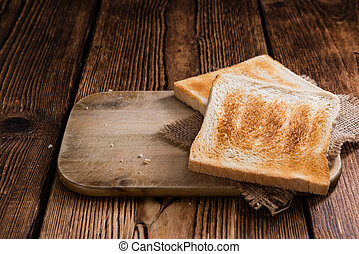 Crispy Toast Bread (selective focus) on wooden background