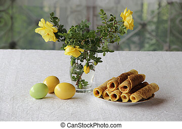 crispy waffles and a bouquet of roses and Easter eggs