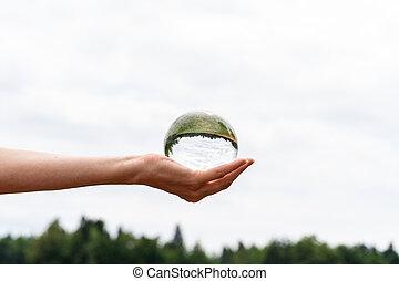 cristal, tenue, sphère, main femelle