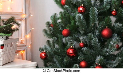 Cristmas tree with red toys on lights background