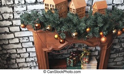 Cristmas tree with toys on fireplace background