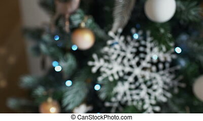 Cristmas tree with toys on lights background