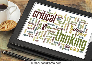 critical thinking word cloud on a digital tablet with a cup...