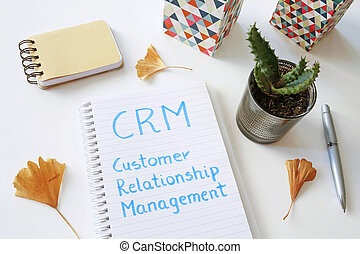 CRM Customer Relationship Management written in notebook