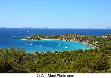 Croatia - beautiful Mediterranean coast landscape in Dalmatia. Murter island beach, Kosirina peninsula - Adriatic Sea. Kornati islands in background.