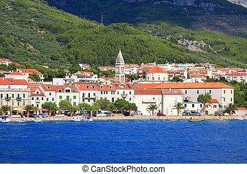 Croatia - Makarska, town in Dalmatia. Old town view with Biokovo mountains in background.