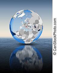 Croatia on globe in water