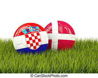 Croatia vs Denmark. Soccer concept. Footballs with flags on green grass