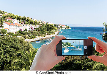 Croatian coast snapshot smartphone - Young European...