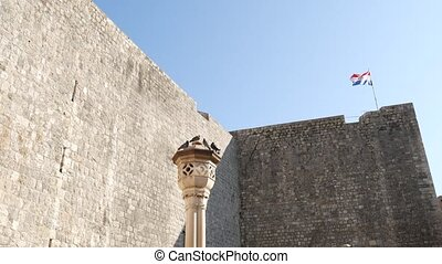 Croatian flag on the walls of the old city of Dubrovnik, ...