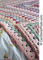 Crochet blanket on bed