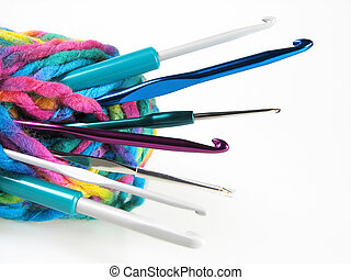 Bale of yarn with hooks for knitting placed on white background