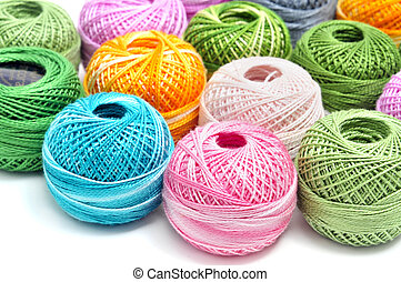 crochet thread of many colors on a white background