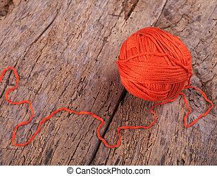 Crochet. Threads on a wooden surface