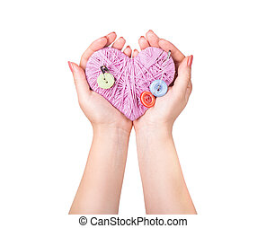 crocheted heart in hand isolated on white