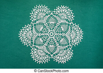 Crocheted lace napkin home decoration on green