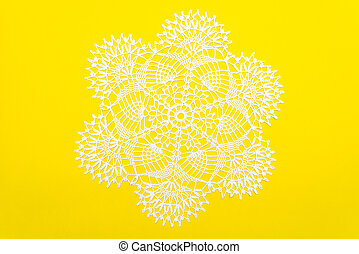 Crocheted lace napkin home decoration on yellow