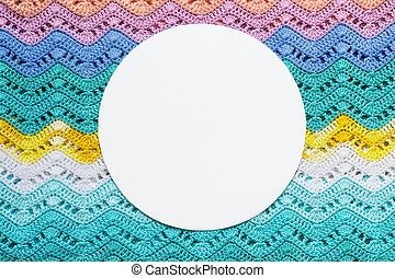 Crocheted multicolored cotton fabric In summer colors. Round white frame for text.