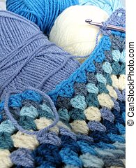 Crocheting a blue baby blanket
