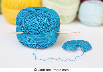 Crochet hook and colorful yarn
