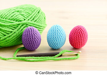crocheting easter eggs in green, pink, blue and purple