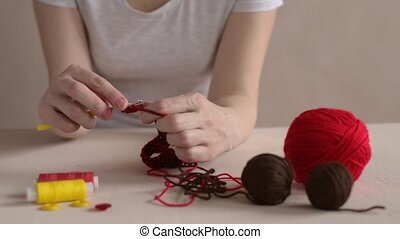 Crocheting woman. Soft focus