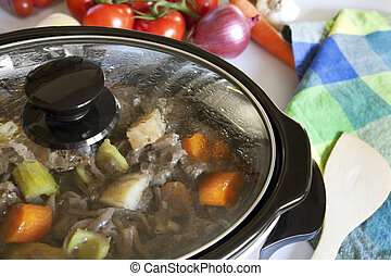 A crock pot slow-cooking a homely beef casserole.