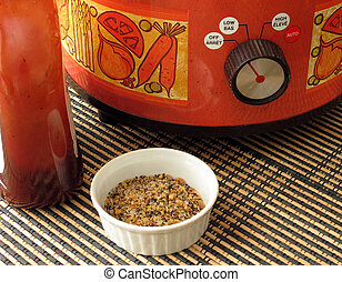 Crock Pot Ingredients - A bottle of barbeque sauce and a...