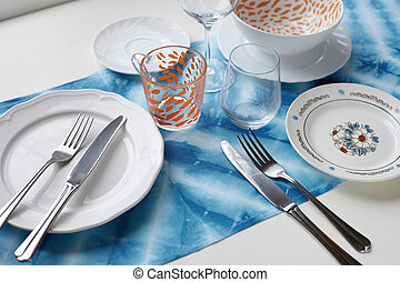 crockery - Empty plate on tabletop with tablecloth close up