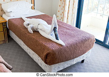 crocodile figure from towels on bed