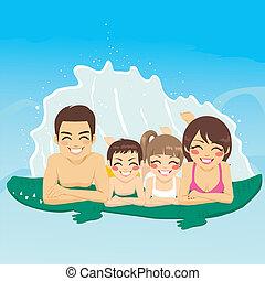 Crocodile Tube Family Vacation - Happy family lying down on...