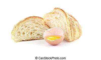Croissant and egg - Fresh croissant and egg on white...