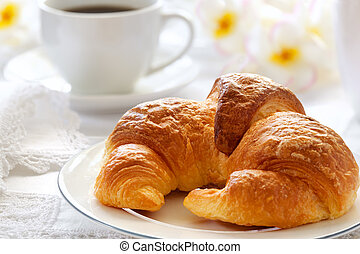Croissant Breakfast - Croissant with coffee, on sunlit...