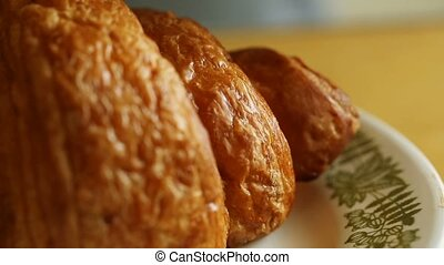 Croissant for breakfast watered chocolate topping, close up...