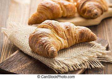 Freshly baked butter croissant. Studio photo.
