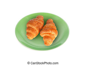 croissant in the green plate isolated on white background